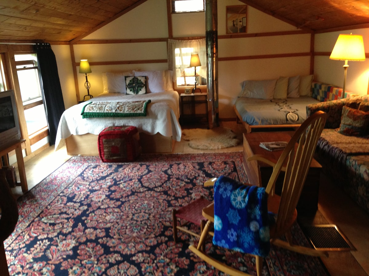 The Upstairs - main bed on left, futon on right and pull out couch on far right