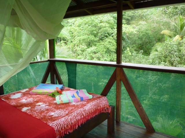 Double bed in 3rd level jungle tower.