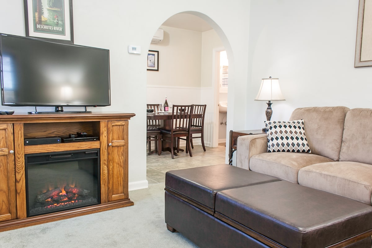Nice fireplace for ambiance with digital cable, HDTV and WiFi TV.