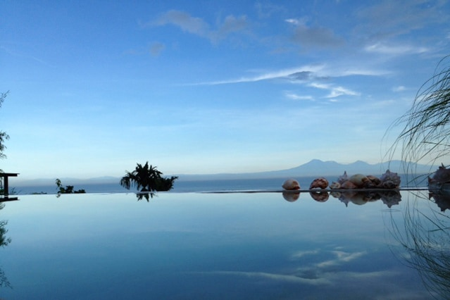 Swimming pool with Balinese mountains in back