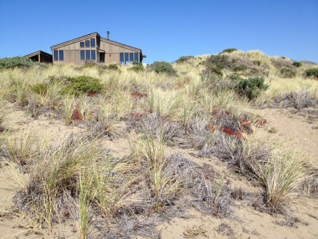One acre on either side that is not developed and provides greater privacy and quiet.