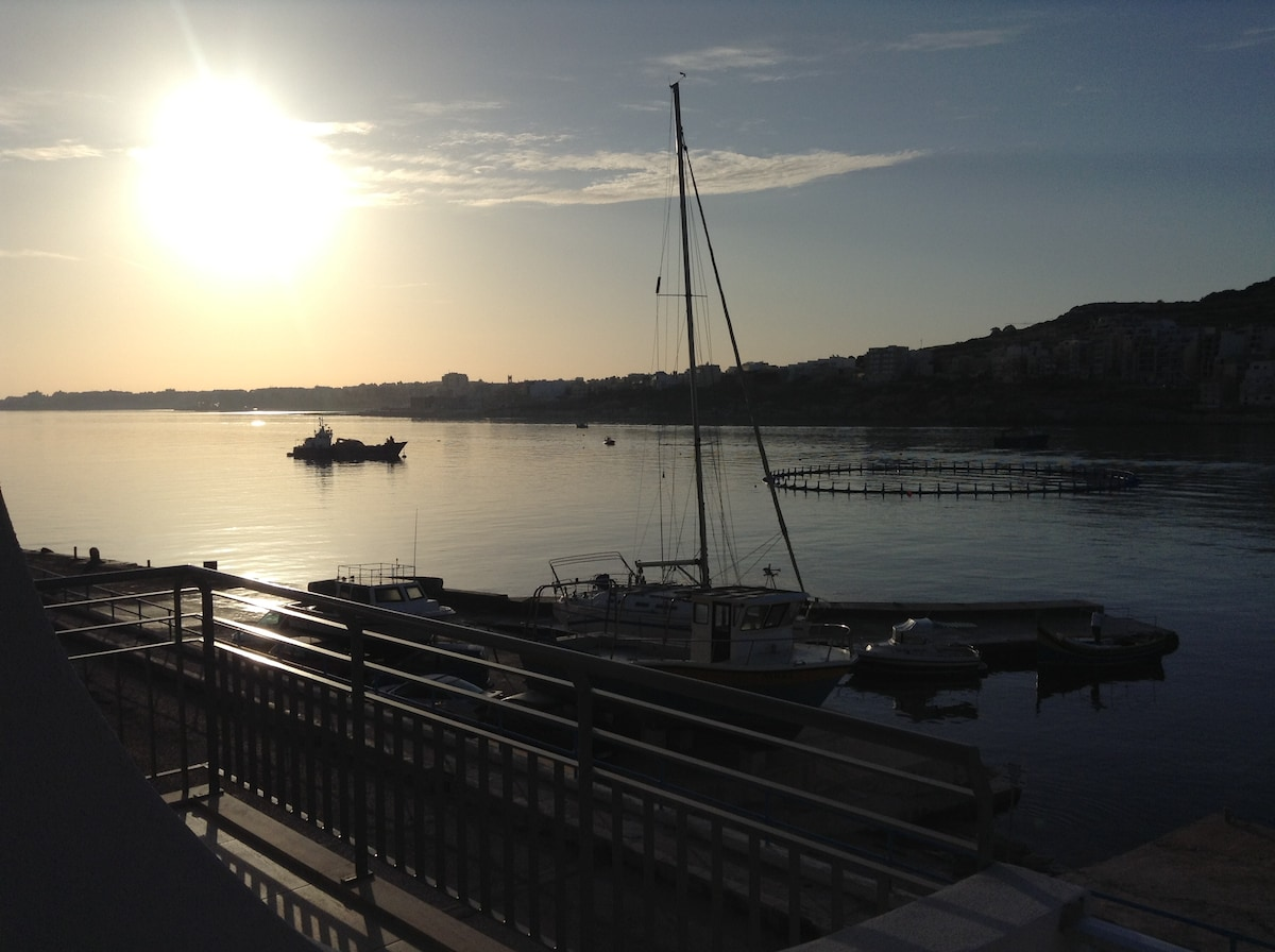Enjoy a serene sunrise on our south-facing terrace. Be tempted to take a dip in the sea below through direct beach access from our internal boathouse!