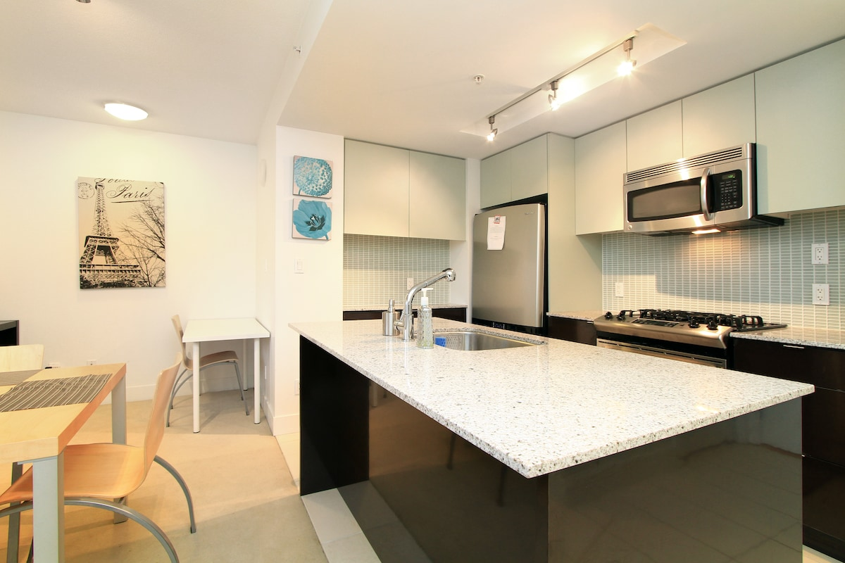 Kitchen with gas stove, refrigeration,  microwave, hood fan, oven, toast oven, dishwasher and more....