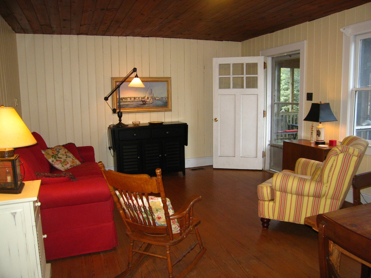 Relaxing living room opens onto the screened porch.