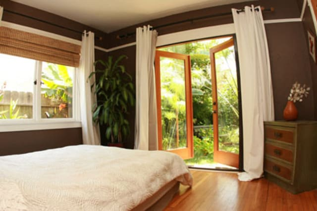main bedroom opens out to private tropical backyard