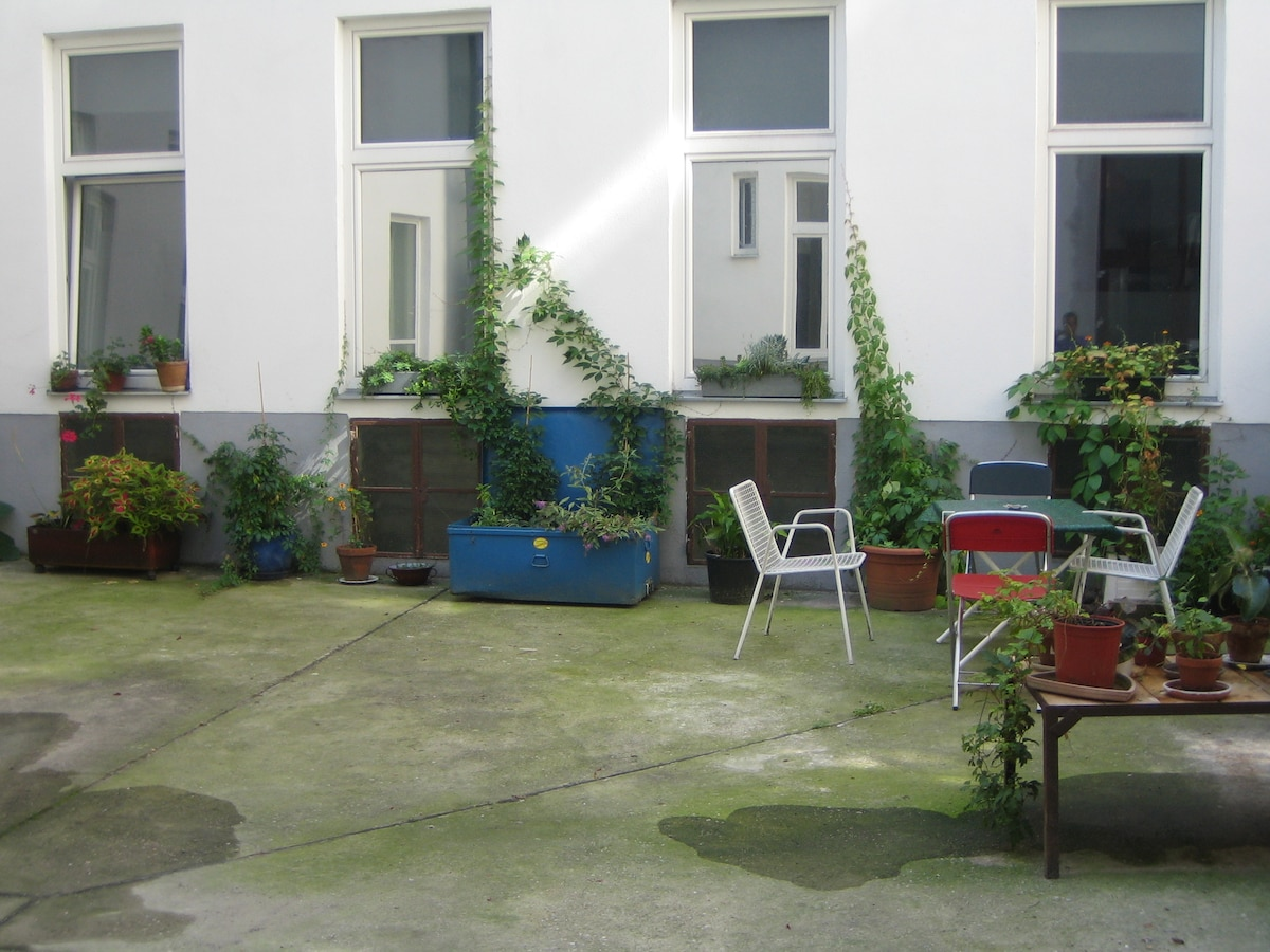 infront of the apartment, table and chairs belong to the apartment and can be used