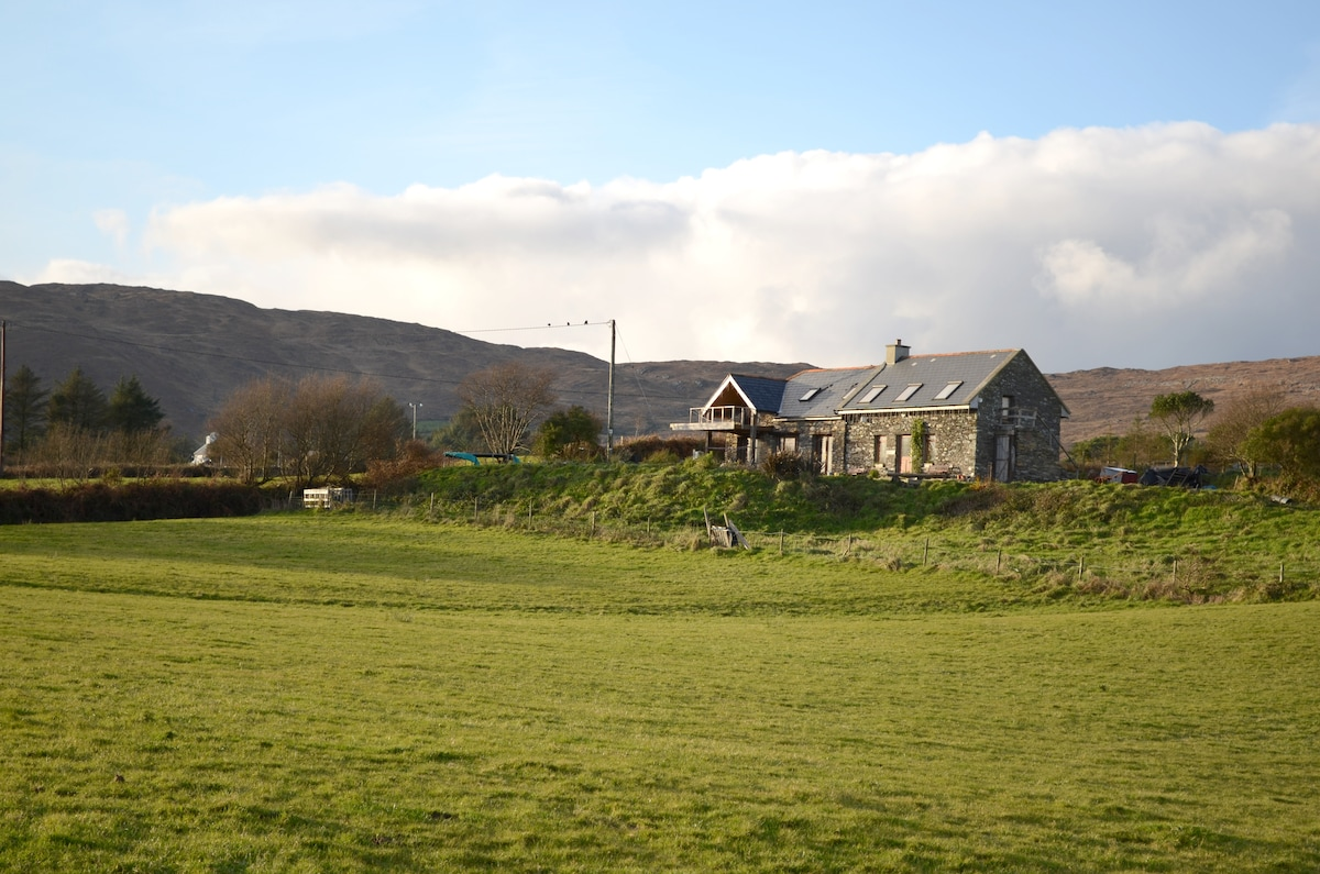 This is the house cottage to right and west wing to left of photo