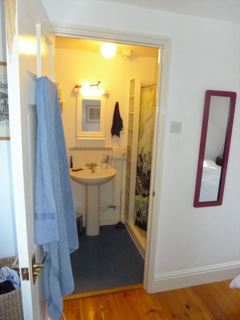 Ensuite bathroom: toilet, sink, shower