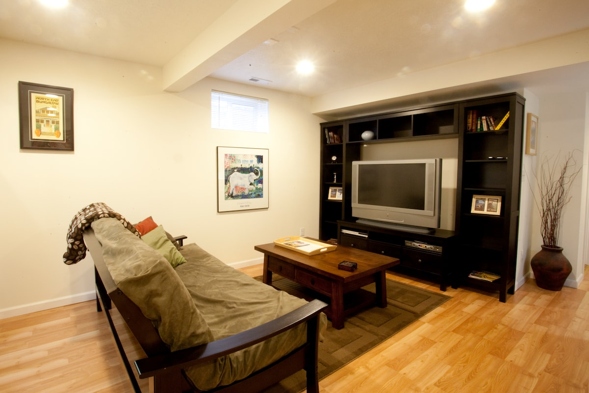 Living room view with large flat screen tv, cable, and DVD player