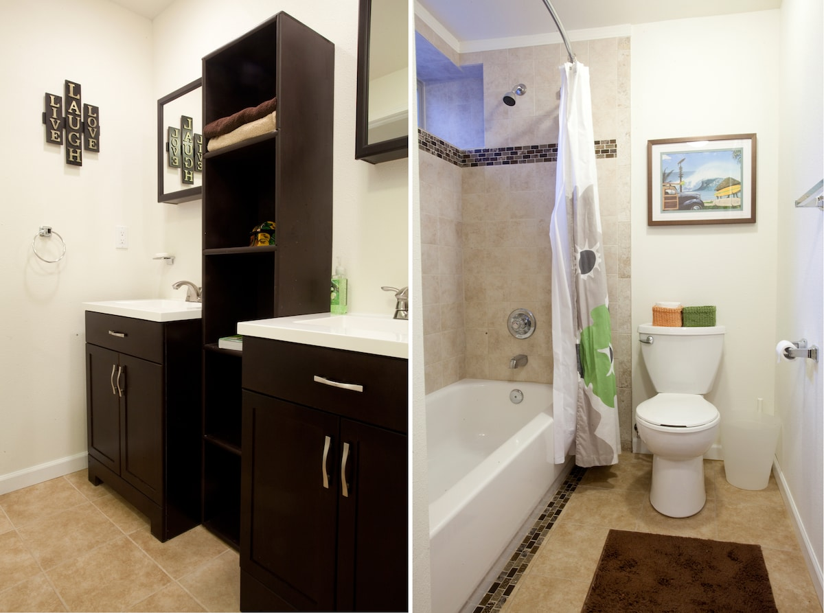 Bathroom with dual vanities, tub and shower.  Tile walls and floor.  Very light, bright, and fresh