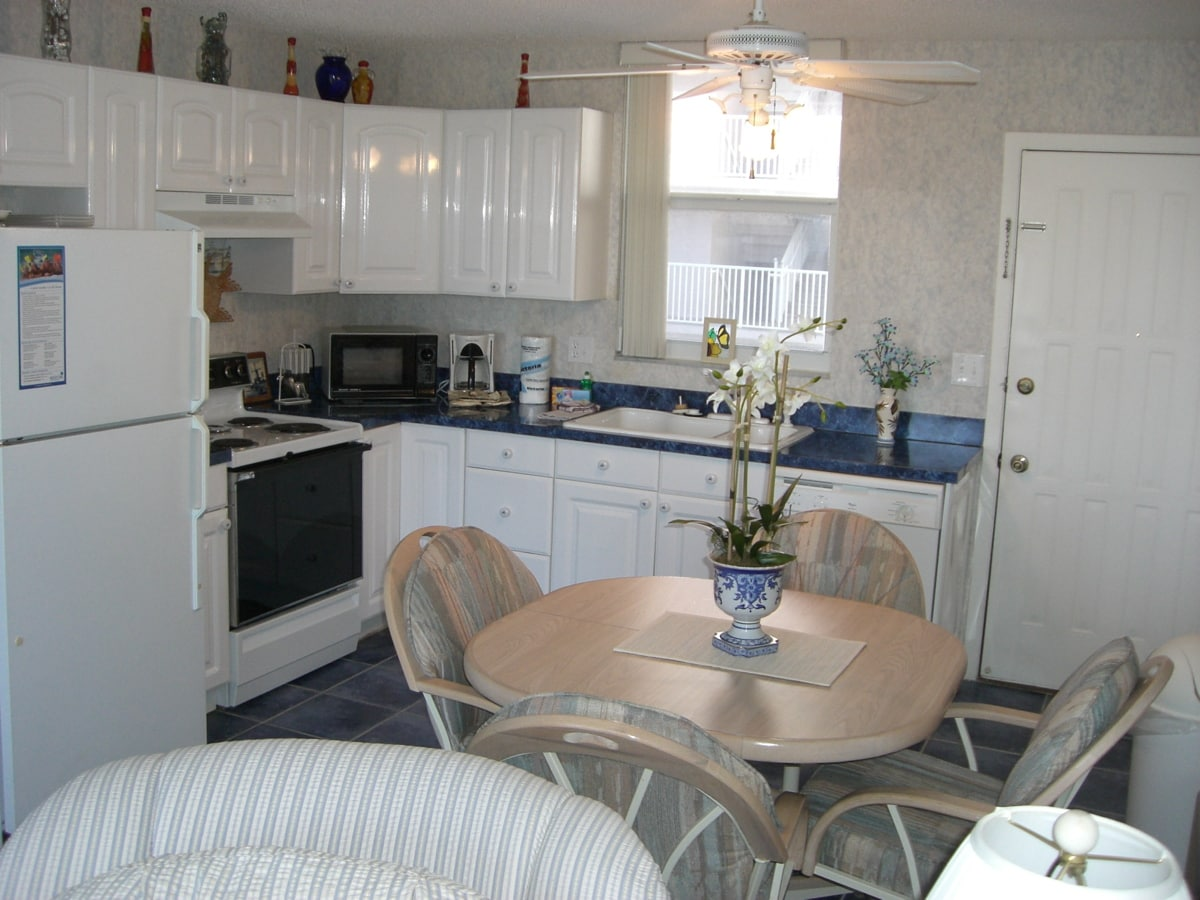 Kitchen is fully equipped with stove, microwave, refrigerator, garbage disposal, and all dishes