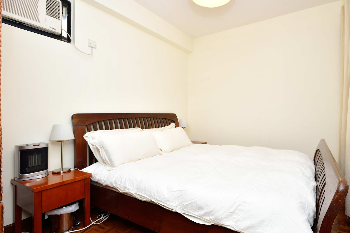 Comfy queen bed with freshly laundered linens.