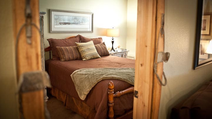 Door to bedroom framed with antique skis.