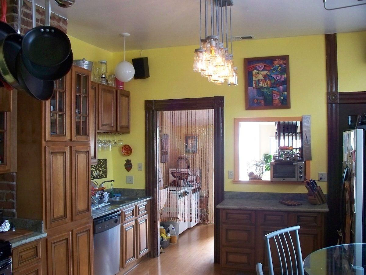 Kitchen is bright and updated and leads to the rear yard sun deck