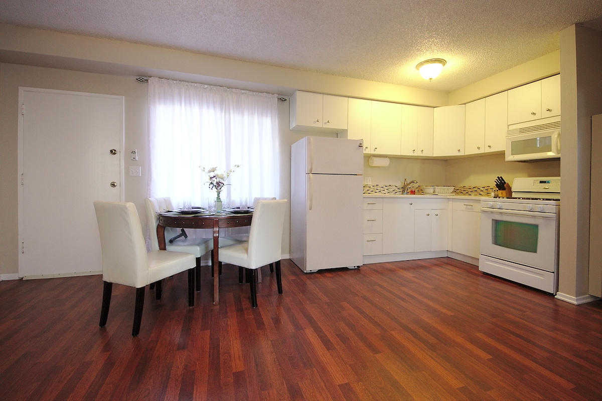 Newly remodeled kitchen with microwave, oven/stove, and full size refrigerator.  Inside the cabinets are all you need to cook your own meals.  Dining seating for four.