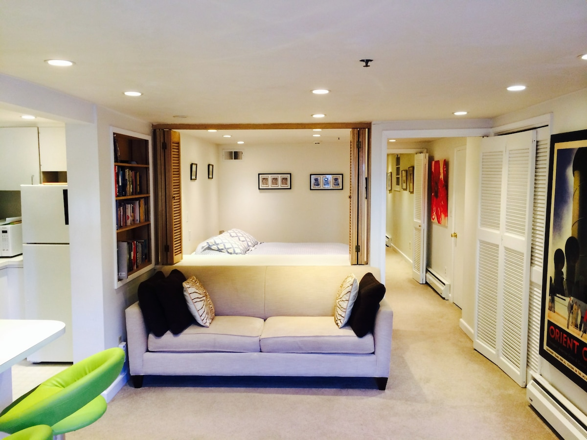 The living area with the bedroom beyond.  Shutters are open but they can be closed to close off the bedroom
