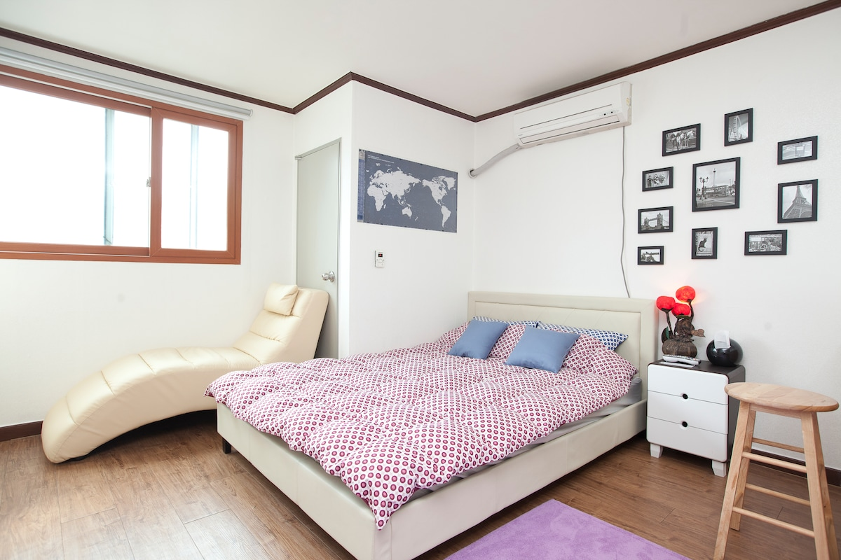Everything you need in this bright, cozy and well decorated private semi studio condo.