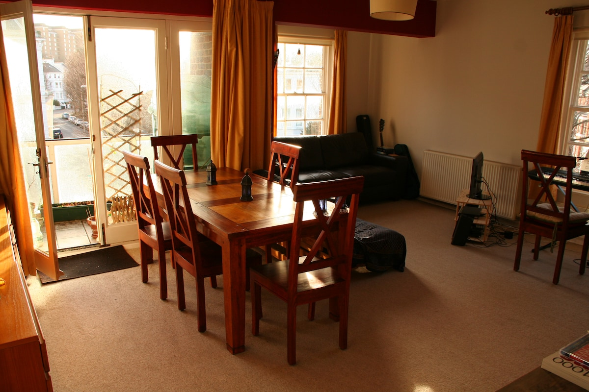 The lounge, with tv, dvd, freeview, hi-fi & lots of cd's & dvds!  Plus a balcony from which you can just see the sea (you could see the beach but it is lower than the street level!)