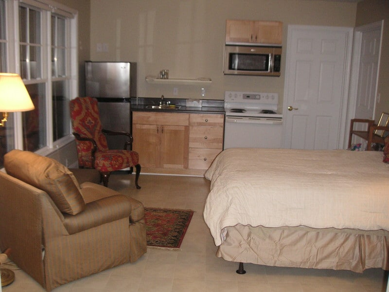 Studio includes full kitchen with housewares and flat panel TV.