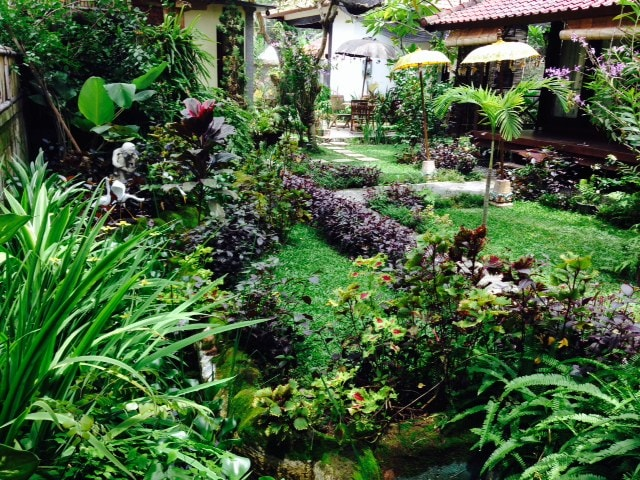 Pathway from villa to kitchen passes through a   beautifully set Balinese garden