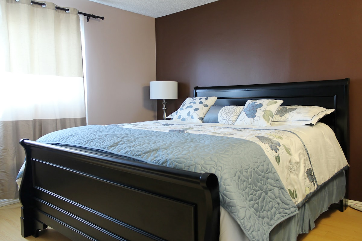 Huge master bedroom with California King bed, walk-in closet, private bathroom