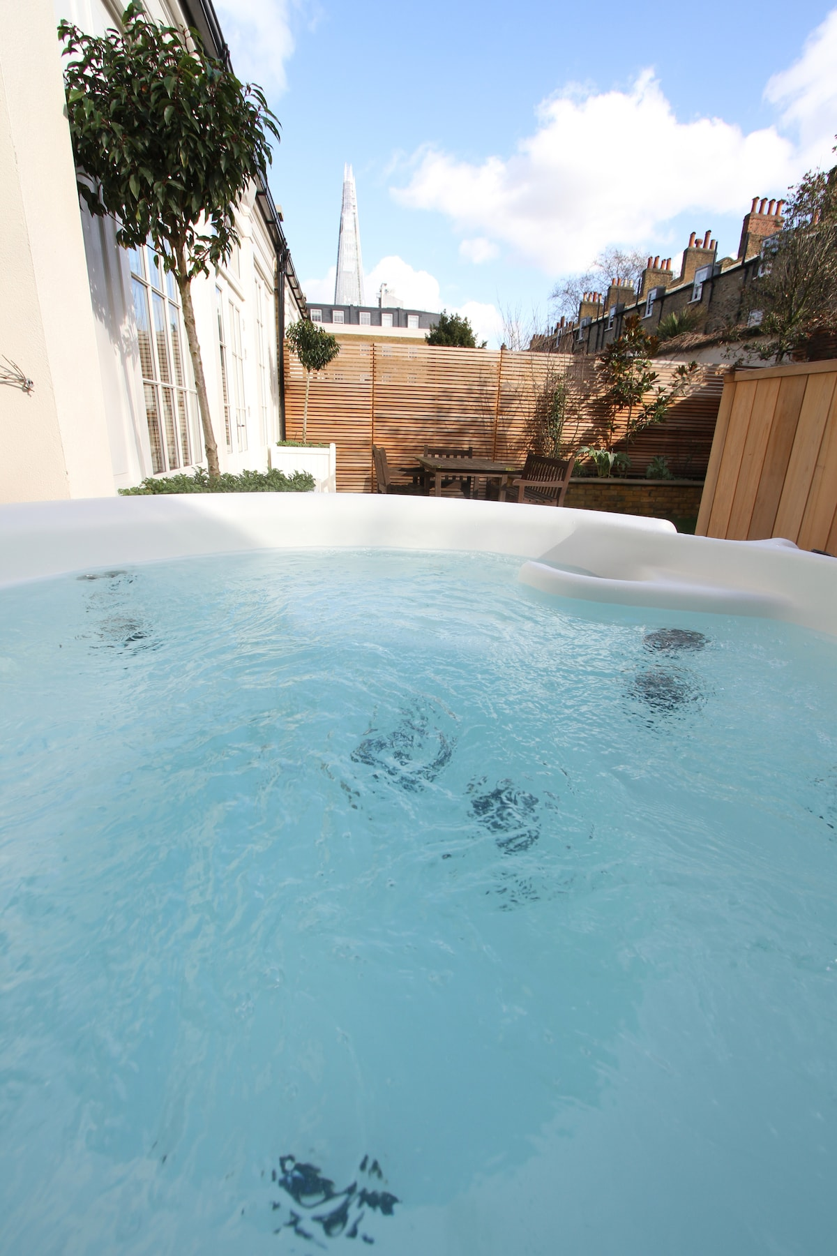 Even if it's not warm out, the hot tub is welcoming and has a stunning view of London's skyline