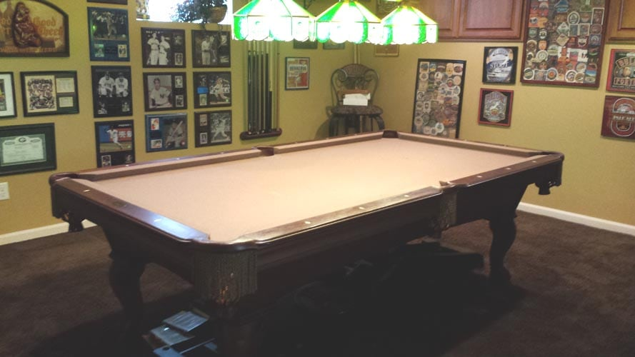 Pool table in basement for guests' enjoyment.