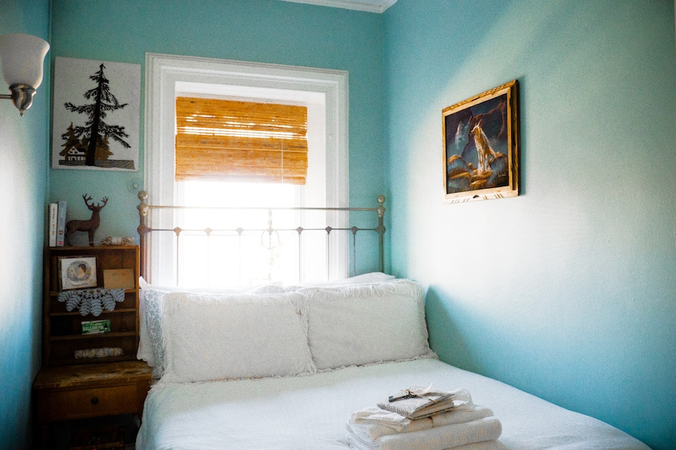 GUEST ROOM: private entrance from stairway hall, boosted WiFi, full bed, antique bedstead, antique brass floor lamp reading light