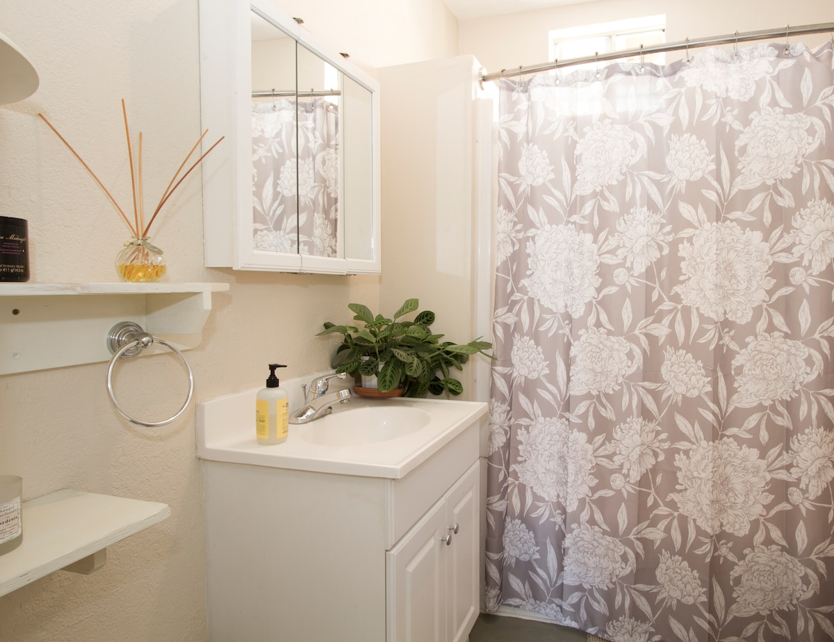This bathroom is shared with whomever is staying in the other guest room. If nobody, it's all yours! But you will have your own private half bathroom to yourself. Stepping back...