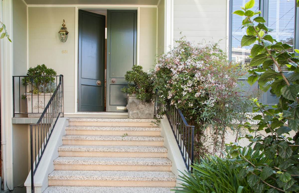 Double front doors lead to over 2300 square feet of luxury living and private garage.