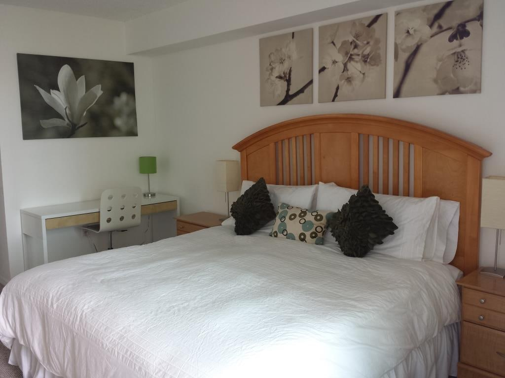 Master Suite with Full Waterfront View, Private Bathroom, Walk-in Closet, and Balcony Access