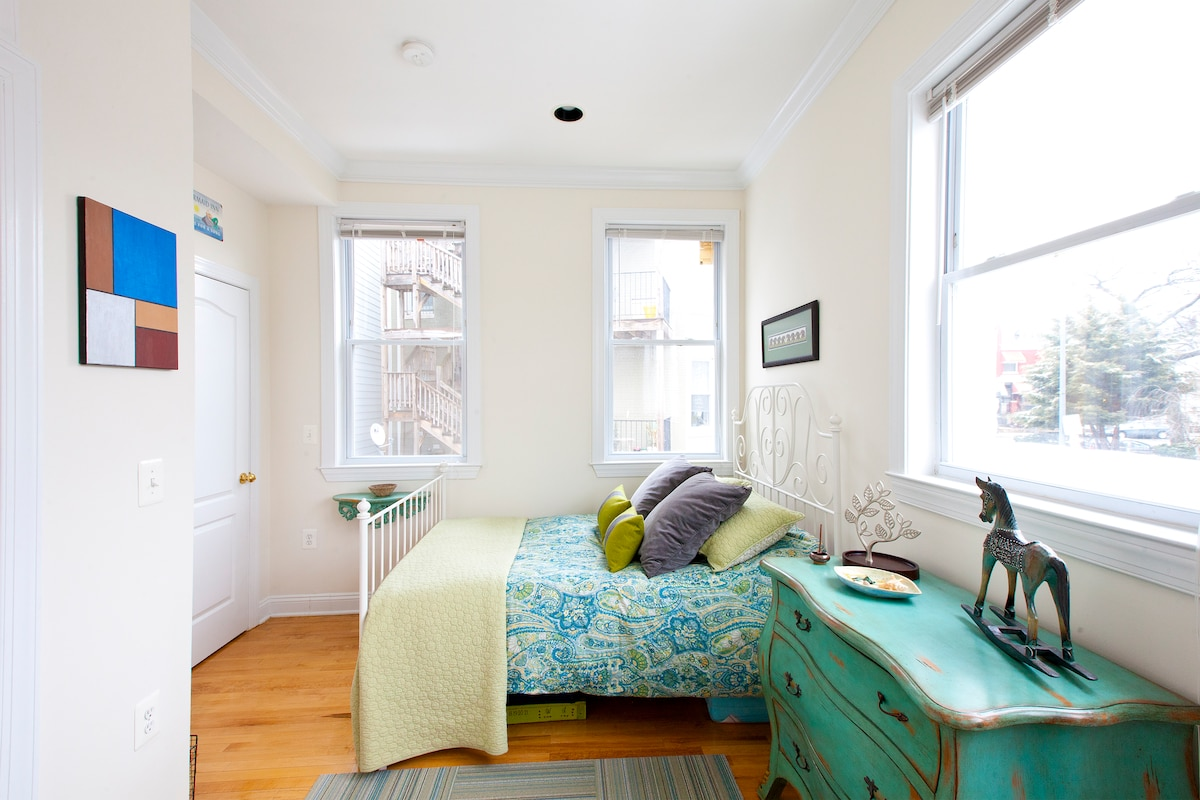 Bright and sunny guest room situated on the corner