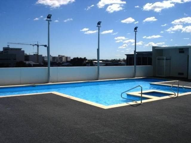 Pool area with tanning beds