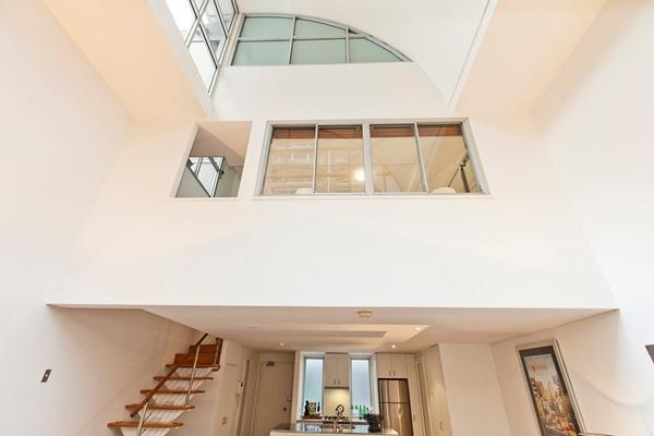 the apartment spanning the height of three floors outlining a uniquely stylish home