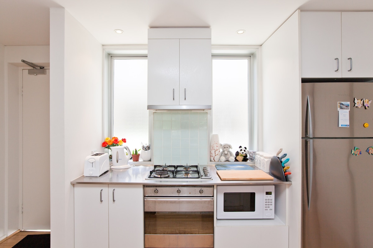 open kitchen with oven & micro wave