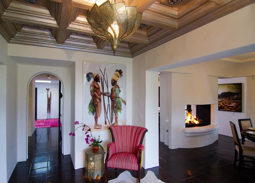 Lobby and open fireplace between kitchen and dining room