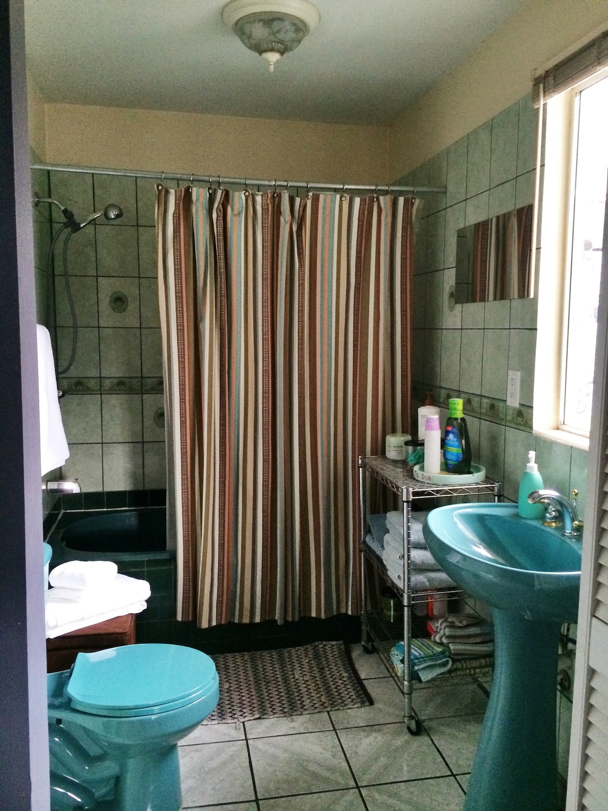 Main bathroom is private for the main bedroom.