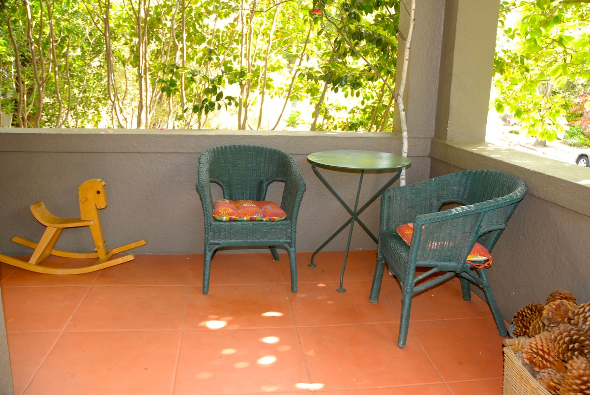 Our front porch: equipped for riders, card players or bird watchers.