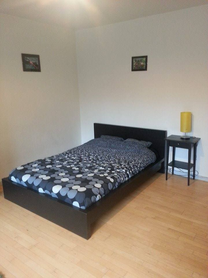 Double bed with night table