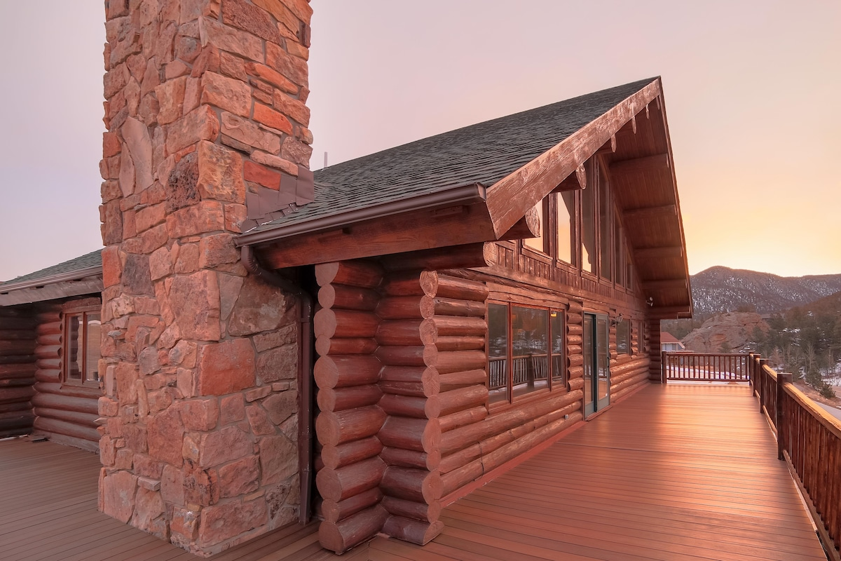 Our log home's side view in Estes Park with brand new composite deck and railing.
