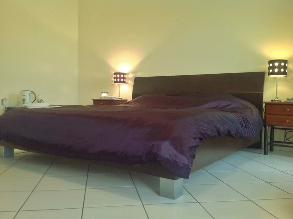comfortable king size bed, reading lamps and tea/coffee tray with kettle and bottled water provided