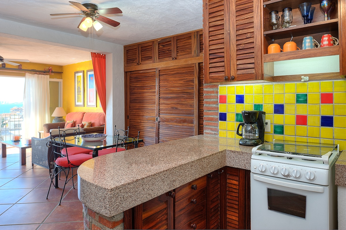 The modern kitchen has granite countertops and modern appliances.