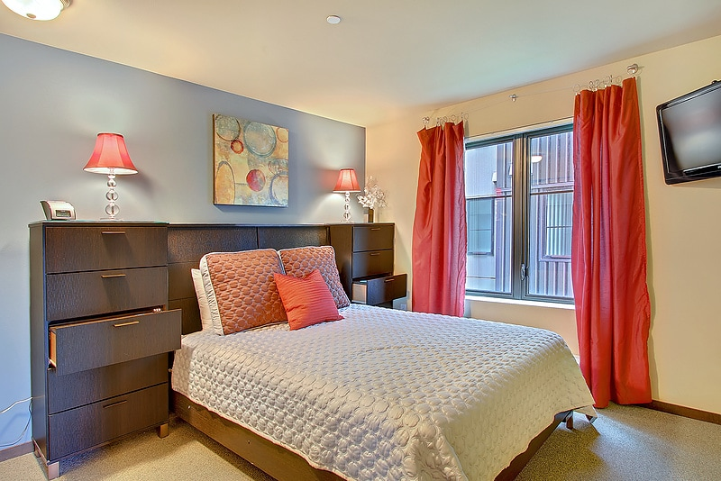 Beautiful Master Bedroom with LCD TV and warm colors!