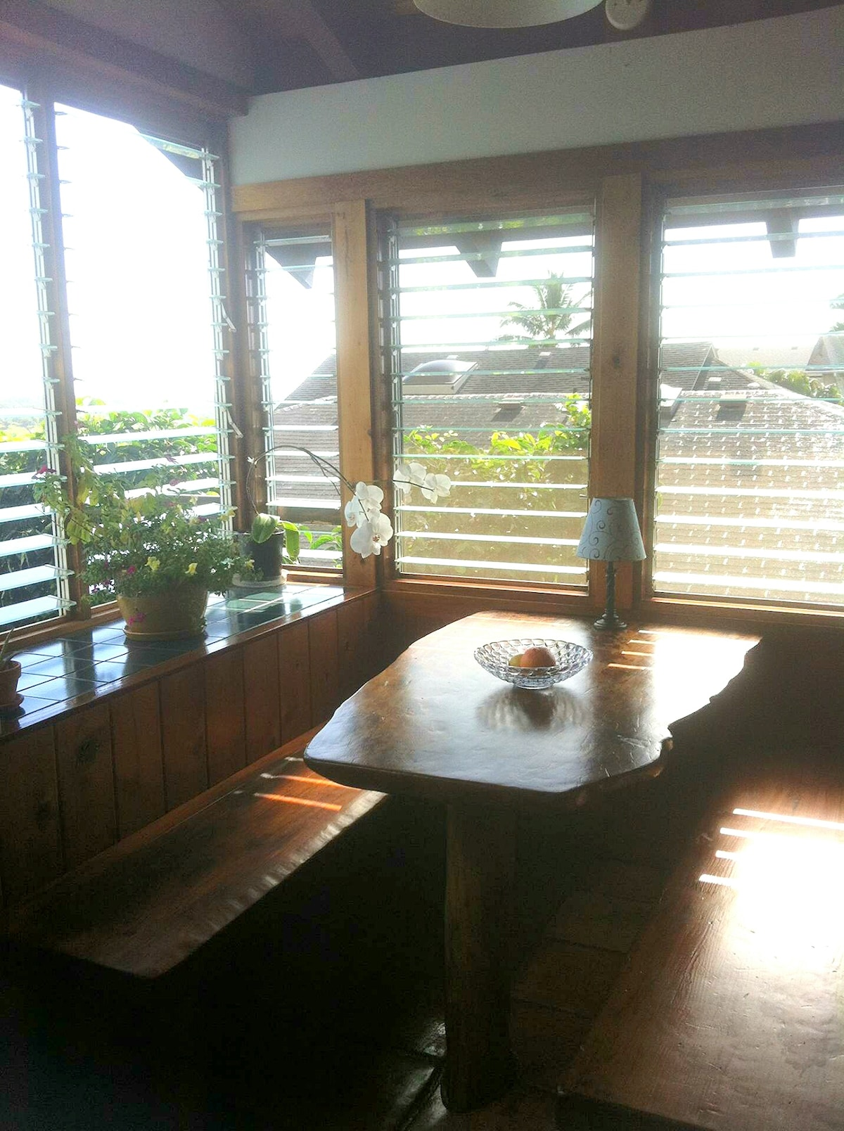 Solid Redwood slab breakfast nook with sweeping views of the mountains and ocean