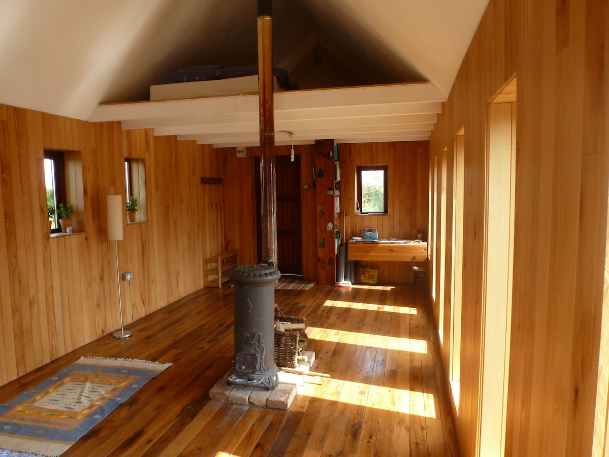 Sleeping loft above wood burning stove