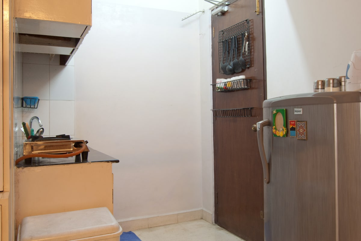 Your own kitchenette with a fridge, sink, single burner gas stove (basic cookware and diningware included)