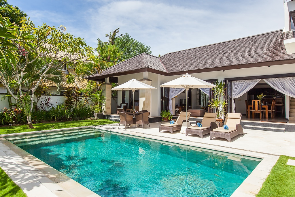 Swimming pool and loungers