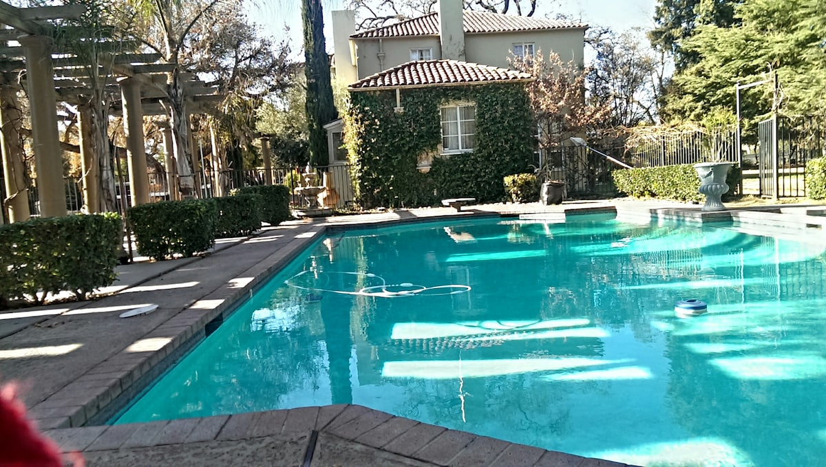 Executive Pool w/ Diving board for swimmers, sunbathers, and a good read by the pool.