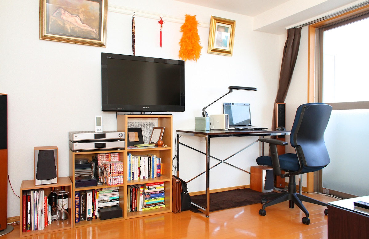 "Desk, flat screen 32"" TV, Amp (Marantz), 4 speakers quality sound system (Yamaha)."