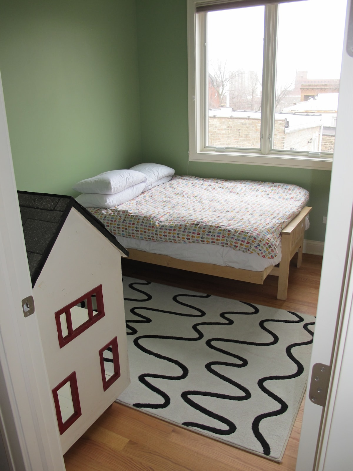 Guest Room with thick comfortable futon mattress, topped with a thick featherbed!